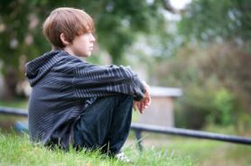 Boy-Sitting-on-Hill_opt