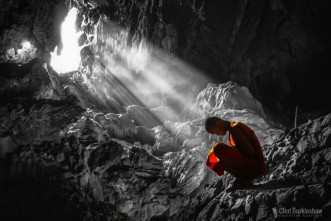 monk praying cave